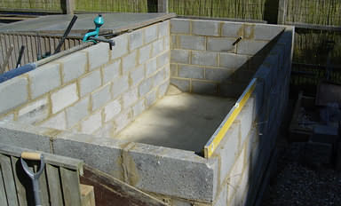 Koi pond construction how to build a perfect koi pond for Cinder block koi pond