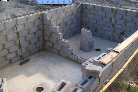 Koi pond construction how to build a koi house for Concrete block pond construction